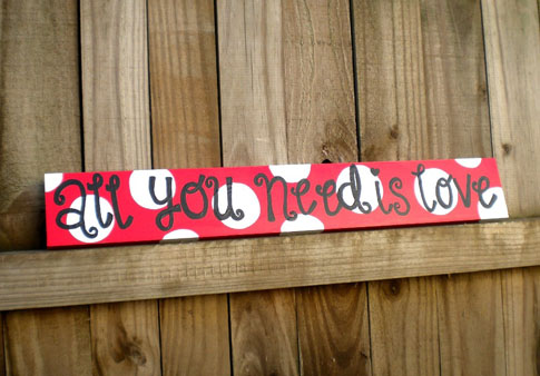 These hand-painted polka dotted signs are perfect for Valentine's Day coming